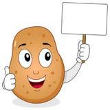 Carácter alegre de la patata y bandera en blanco Foto de archivo