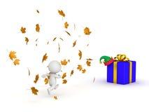 carácter 3D que corre a través de Autumn Leaves para conseguir a los regalos del invierno Imagen de archivo