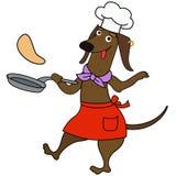 Carácter del cocinero del perro basset de la historieta con las crepes Foto de archivo libre de regalías