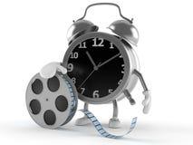Carácter del despertador con el rollo de película Imagenes de archivo