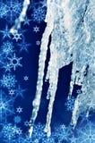 Carámbanos y copos de nieve del invierno de la textura del fondo Fotografía de archivo