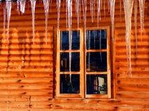 Carámbanos y ventana Foto de archivo libre de regalías