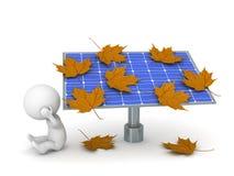 Caráter 3D triste e painel solar cobertos com Autumn Leaves Fotografia de Stock