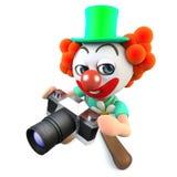 caráter engraçado do palhaço dos desenhos animados 3d que guarda uma câmera Fotos de Stock Royalty Free