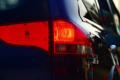 Car's红色背后照明背景照片 免版税图库摄影
