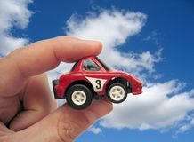 Car 1. Handheld toy car against sky Stock Images