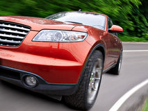 Car. Modern red car in motion. close up Royalty Free Stock Photo
