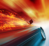 Car. Burning sport car in motion with red blurry clouds Royalty Free Stock Image