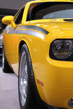 Car. Image of yellow sports car with black stripes, front view Stock Image