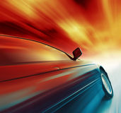 Car. Blurry sport car with red sky and clouds Royalty Free Stock Image