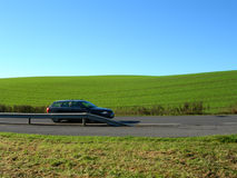 Car. Grain field and blue sky Stock Image