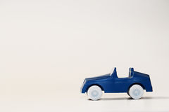 Car. A blue plastic car and a white background Royalty Free Stock Photography