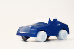 Car. A blue plastic car and a white background Royalty Free Stock Photo