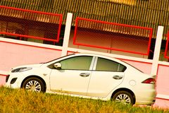 Car. White car parking near pink wall Stock Image