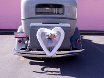 Car. Old classic wedding car with white heart Stock Image