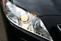 Car. Forward headlight of the black luxury car Royalty Free Stock Photography
