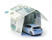 Car. In house of money, isolated Royalty Free Stock Photo