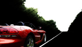 Car. Driving red modern cabriolet on the road Stock Photos