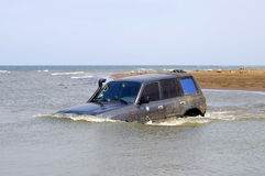 Car 4x4 moves the river Royalty Free Stock Photo