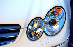 Car. The front of a white car with head lights Stock Photo