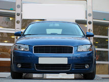 Car. Blue luxury car  on a ramp Royalty Free Stock Image