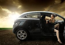Car. Beautiful girl sitting in a sport car Stock Photography