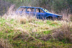 Car abandoned in countryside Stock Photo