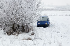 Car abandoned on the filed in winter Royalty Free Stock Images