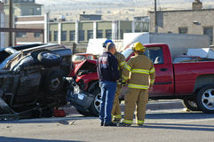 Car Accident. With emergency people investigating the scene Stock Image