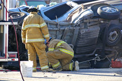 Car Accident. With emergency people investigating the scene Stock Images