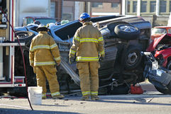 Car Accident. With firemen investigating the scene Stock Images