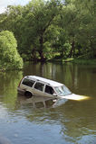 Car accident. Accident - white car swimming in the river Royalty Free Stock Images