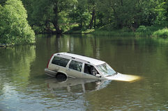 Car accident. Accident - white car swimming in the river stock photos