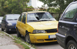 Car accident. Yellow car with a broken windshield Royalty Free Stock Photos