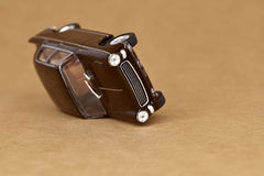 Car accident. A brown toy car tumbled Stock Photography