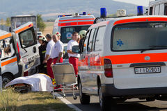 Car accident. PÉCS, HUNGARY - SEP 15: Firefighters help the victim of car accident on Sep 15, 2011 on Road 6 in Pécs, Hungary Royalty Free Stock Image