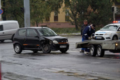 Car accident. PÉCS, HUNGARY - OCT. 21: For car crashed. Repairmans try to help the victim of car accident on Oct 21, 2011 on Road 6 in Pécs, Hungary Stock Photography