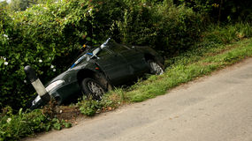 Car accident. Crashed car in a ditch Royalty Free Stock Photo