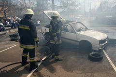 Car accident. Fireman fighting fire after a car accident Stock Photos
