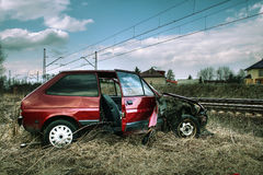 Car accident. Crashed red small car near railway track royalty free stock photos