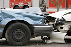 Car accident. Full frame view of a motor vehicle accident MVA with a red fire truck in the background royalty free stock photos