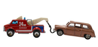 Car accident. A car being towed away by red tow truck Stock Photography