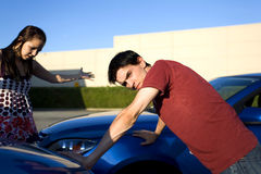Car accident. People in a car accident situation at day time Stock Images