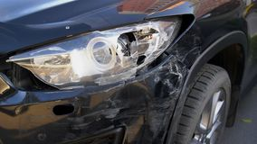 The car after the accident, close up car crashed headlight