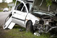 Car accident Crash. Car after accident (crash) on the side of the road. Tottaly damaged. Wrecked car Stock Photos