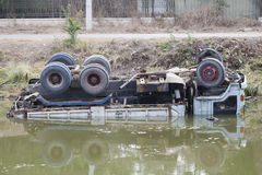 Car accident. The car fell into the river and capsized Stock Image