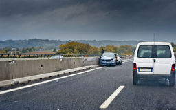 Car accident on a highway. An accident with two cars creates a queue on a highway on a rainy day Stock Photography