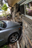 Car Accident into house. Smashed wall silver volvo Royalty Free Stock Images