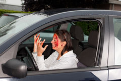 Car accident panic. Young woman in panic looking at her bloody hands after a car crash Royalty Free Stock Photos