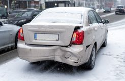 Car accident on the road in winter city